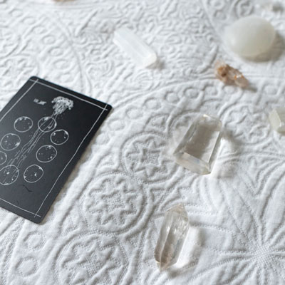 close-up of tarot card and crystals